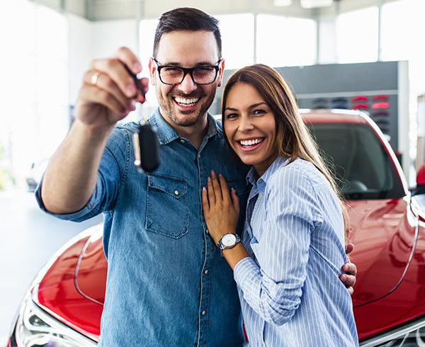 Couple holing car keys