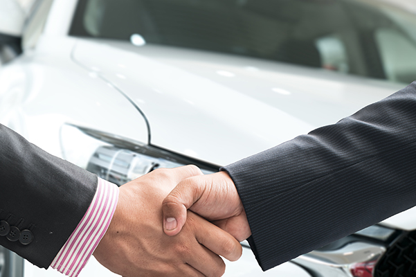 Subaru Customer Shaking Hands With Finance Manager