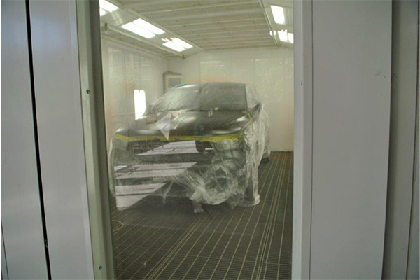 a vehicle exterior being painted