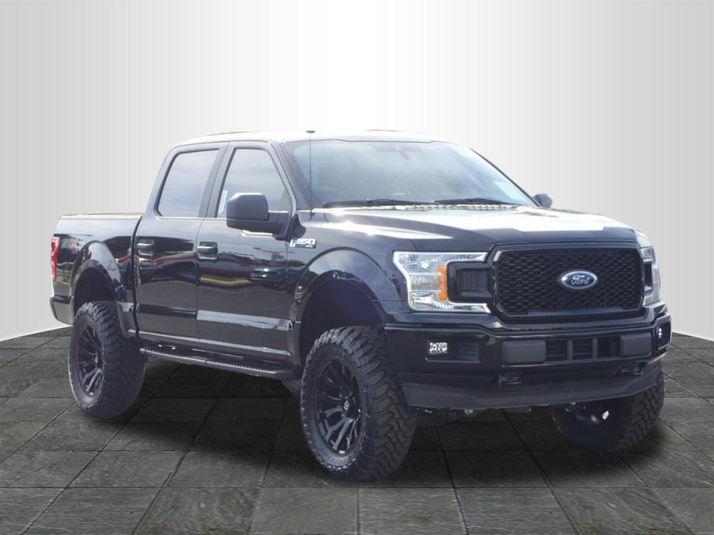 dark blue lifted truck