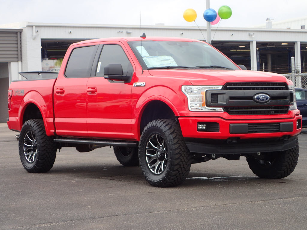 red lifted truck