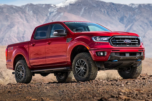 2021 Ford Ranger with Ford Performance Level 1 Package in Rapid Red Extra Cost Option parked on desert hill