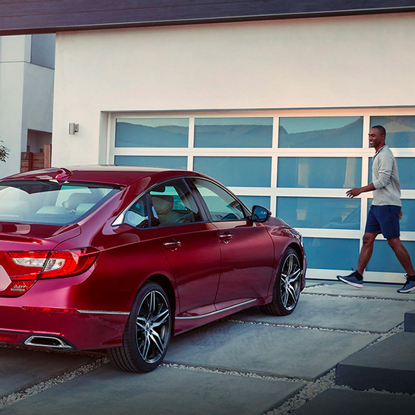 man walking beside a new 2021 honda accord