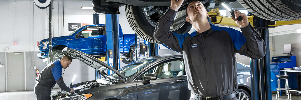 Ford Service Dealership - Techs Working