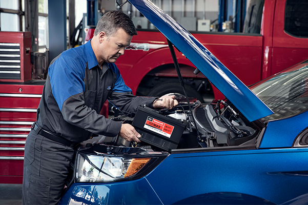 lacing New Battery in Car-Side