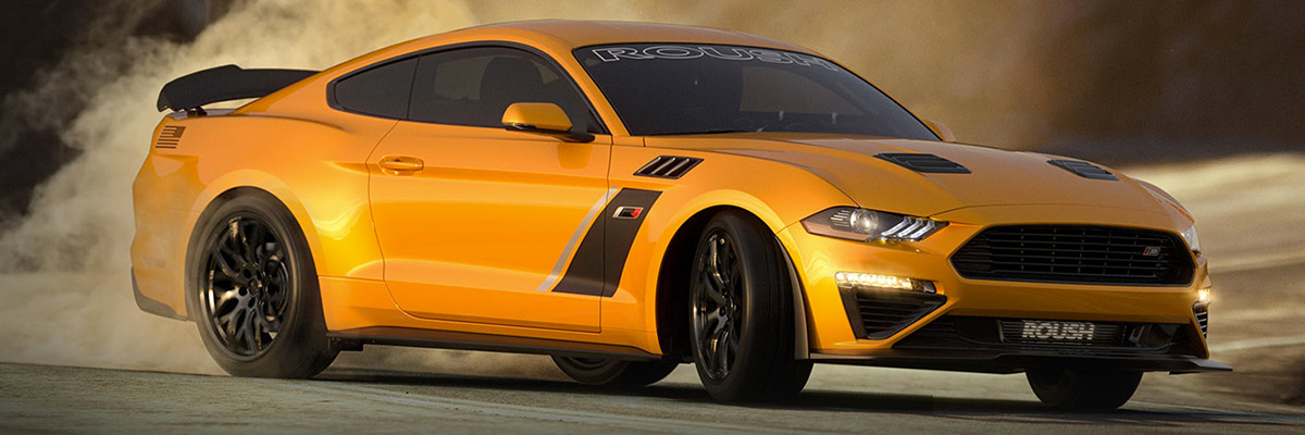yellow mustan Roush Performance Vehicle drifting on a curve