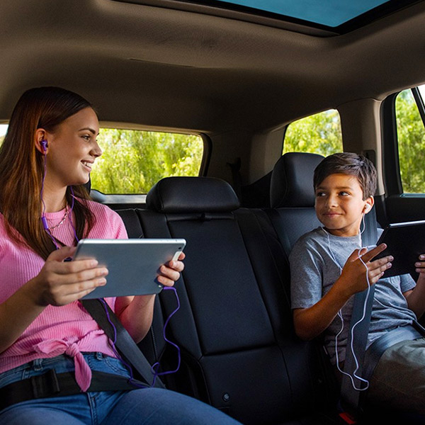 two kids connecting bluetooth streaming inside vw tiguan suv