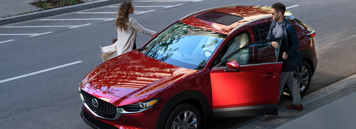 Couple getting in their new Mazda CX-30