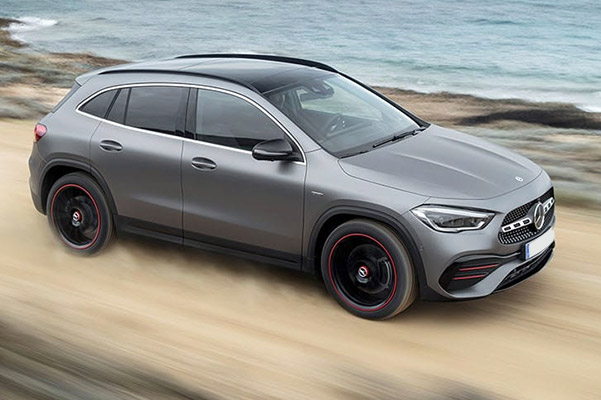 gray Mercedes-Benz GLA going at high speed through the sand next to beach