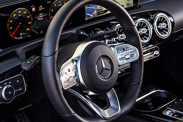 Steering wheel and dashboard of a Certified Pre-Owned Mercedes-Benz vehicle
