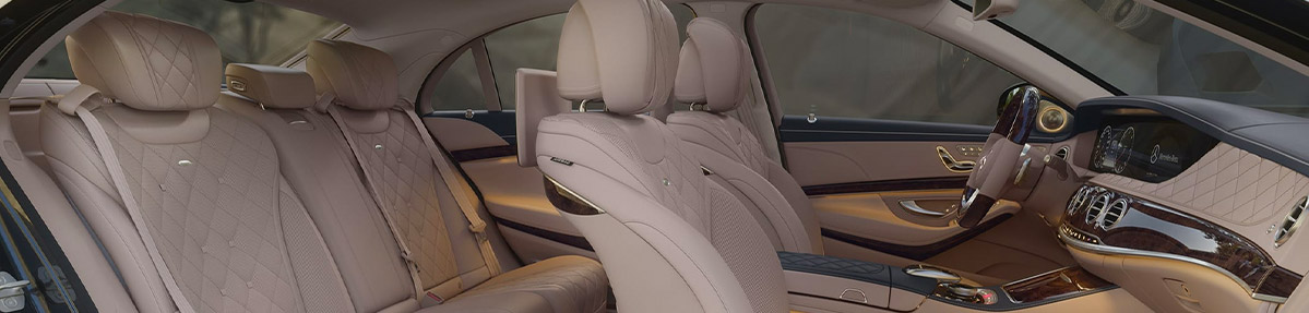 side view interior of a mercedes benz s class sedan featuring white leather seats