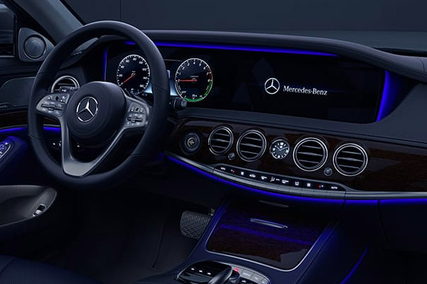 interior view of mercedes benz s class sedan featuring drivers dashboard and digital screen