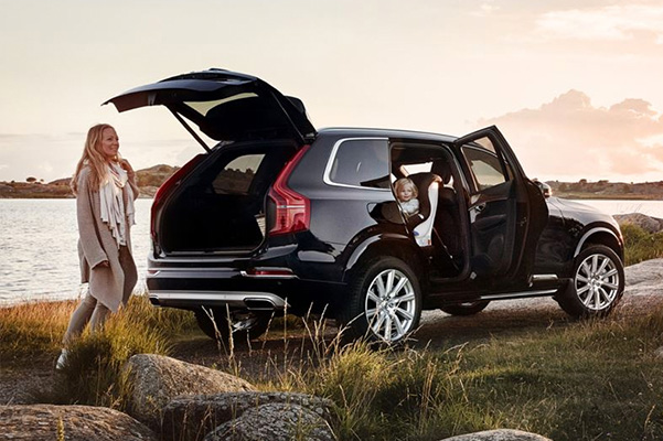 Exterior shot of a Certified Pre-Owned Volvo SUV with kids in the back seat and the hatch open