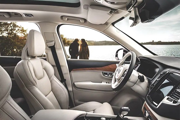 Interior of a Certified Pre-Owned Volvo SUV with a body of water in the background