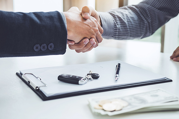 Handshake of cooperation customer and salesman after agreement, successful car loan contract buying or selling new vehicle