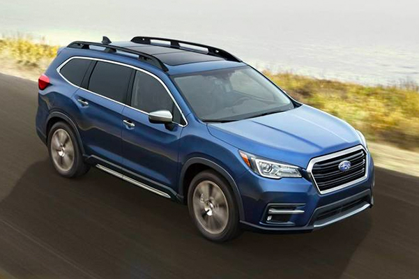 A 2021 Subaru Ascent Touring on a country road.