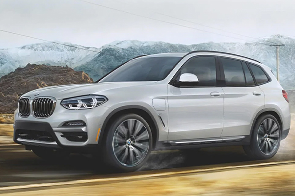 A plug-in electric hybrid BMW X3 xDrive30e on a long range drive through the mountains