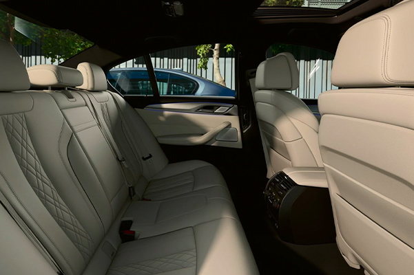 The spacious cabin of the 2021 BMW 5 Series Sedan provides space for your passengers on every drive.