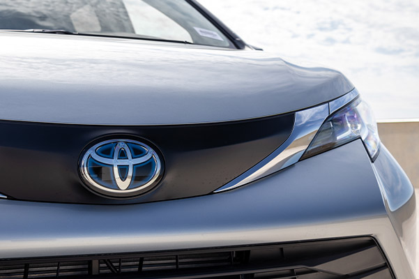 close up of 2021 toyota sienna van grill showcasing toyota logo