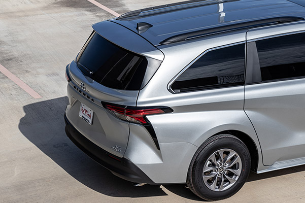 close up of rear view of 2021 toyota sienna van parked on a parking lot
