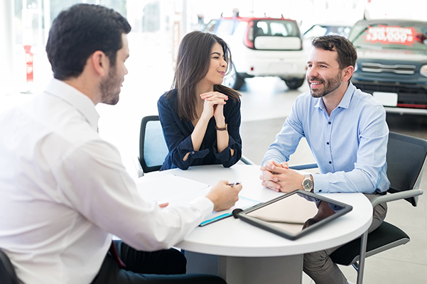 Ford customers sitting with a finance manager with the goal of buying their lease