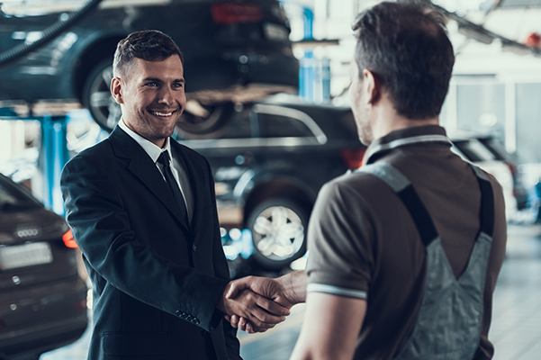 Customer shaking a mechanic's hand